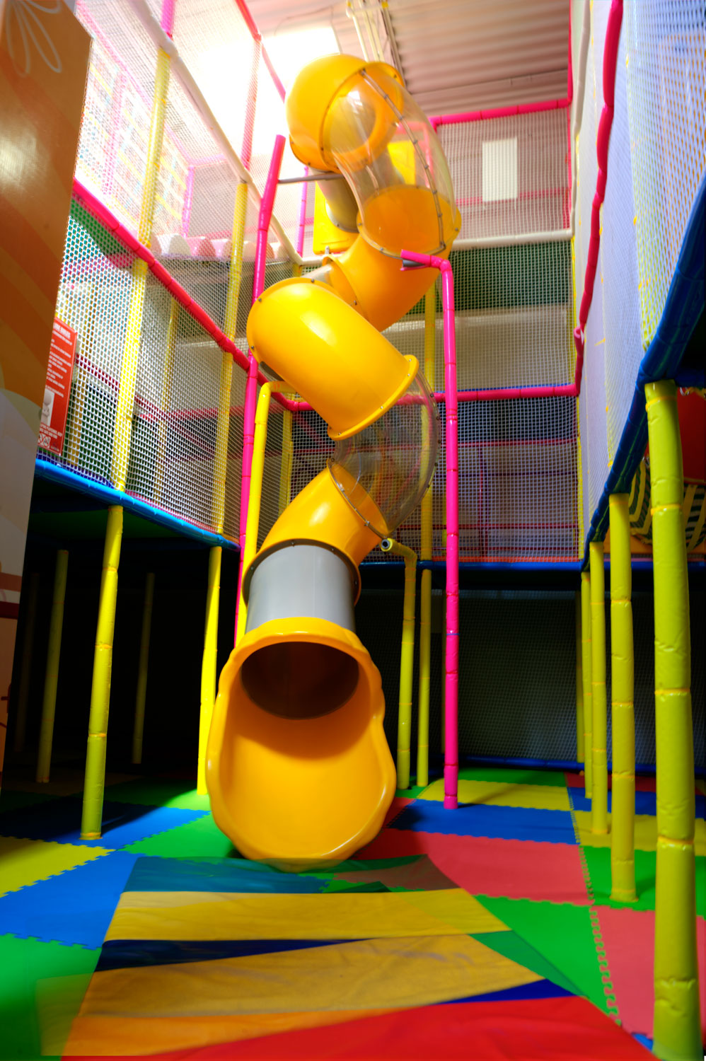 Photo gallery playcious indoor playground with for Indoor play slide